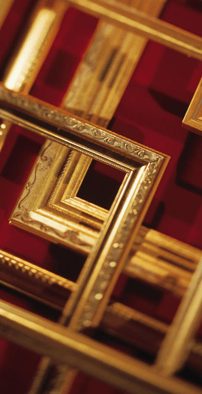 image of gold frames on wooden table